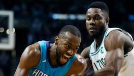 Charlotte's Kemba Walker drives past Boston's Semi Ojeleye during a Nov. 10, 2017 game in Boston.
