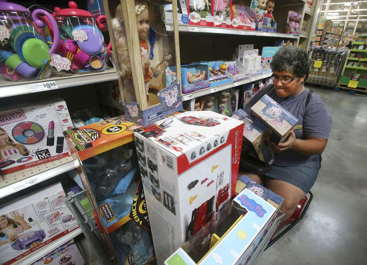 Maria Anthony shops Friday November 24, 2017 at the H-E-B on South New Braunfels on Black Friday. She was buying toys for her granddaughter.