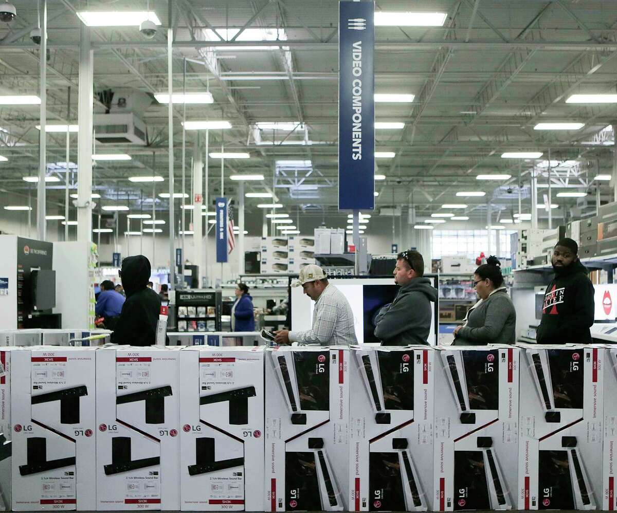 Shoppers line up to check out with their Black Friday deals at Best Buy on Friday, Nov. 24, 2017, in Houston.