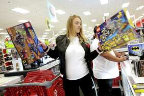 Brittany Williams of Houston checks out at Target with gifts she bought on  Friday, Nov. 24, 2017, in Houston.