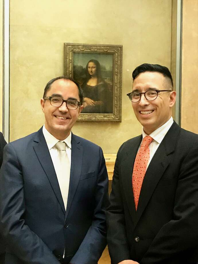 Fernando Luis Alvarez, Stamford gallery owner and founder of the Clementina Arts Foundation, right, recently was invited to the Louvre in Paris for a private dinner of patrons. Alvarez met with Jean-Luc Martinez, the president-director of the museum, where the Mona Lisa is housed, background. Photo: Contributed Photo / Contributed Photo / Stamford Advocate Contributed