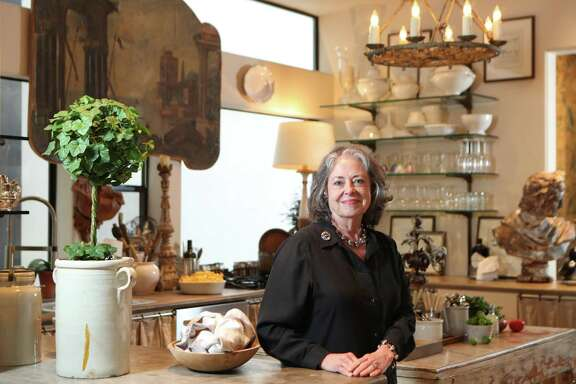 Donna Brown has filled her home above her antiques store, The Gray Door, with unique pieces, each with a story or experience attached.