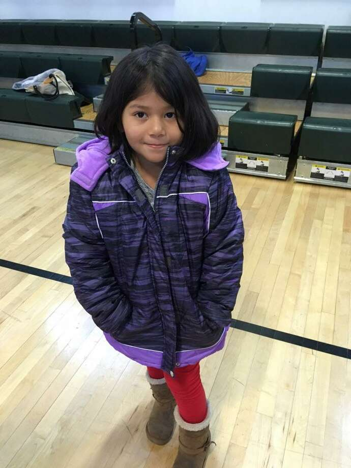 Cynthia Sanchez, 5, models her new coat at the Knights of Columbus Black Friday coat giveaway on Nov. 24, 2017 in Bridgeport. Photo: Linda Conner Lambeck /