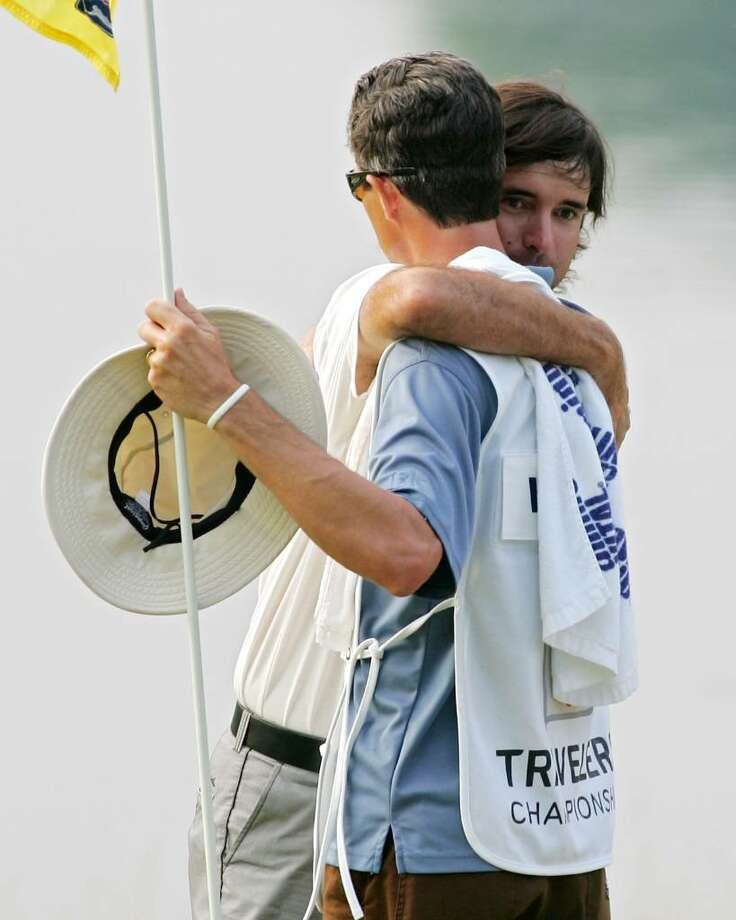 CROMWELL, CT - JUNE 27:  Bubba Watson embraces  his caddie, Ted Scott, after winning a two-hole playoff after the final round of the Travelers Championship held at TPC River Highlands on June 27, 2010 in Cromwell, Connecticut.  (Photo by Michael Cohen/Getty Images) *** Local Caption *** Bubba Watson;Ted Scott Photo: Michael Cohen, Getty Images / 2010 Getty Images