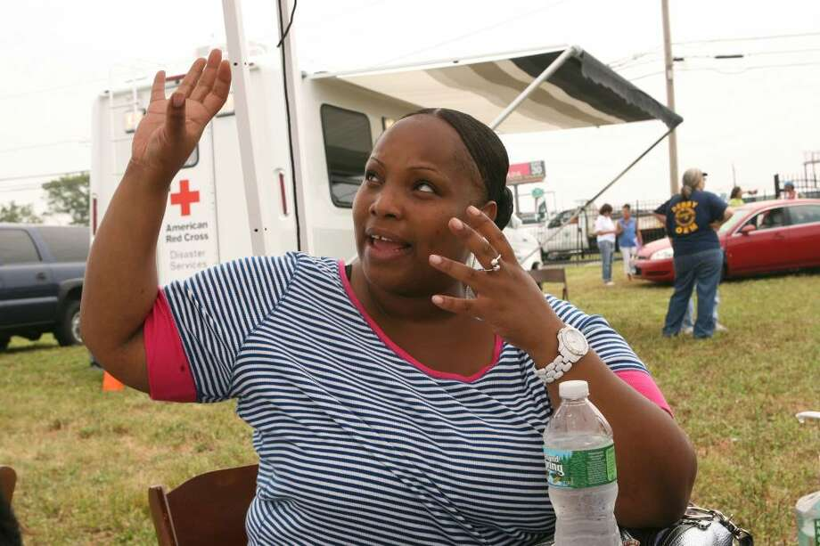 Lisa Coulthirst tells Red Cross volunteers how the roof of her Bridgeport apartment building lifted during the tornado. The Red Cross was  taking information from Bridgeport tornado victims  on Sunday, June 27, 2010, and will be doing outreach into the neighborhoods this week. They set up resources to help victims find shelter and to offer food, water, and clothing.The Red Cross is taking donations by phone (877)  287-3327 or online at www.ctredcross.org. Photo: B.K. Angeletti / Connecticut Post