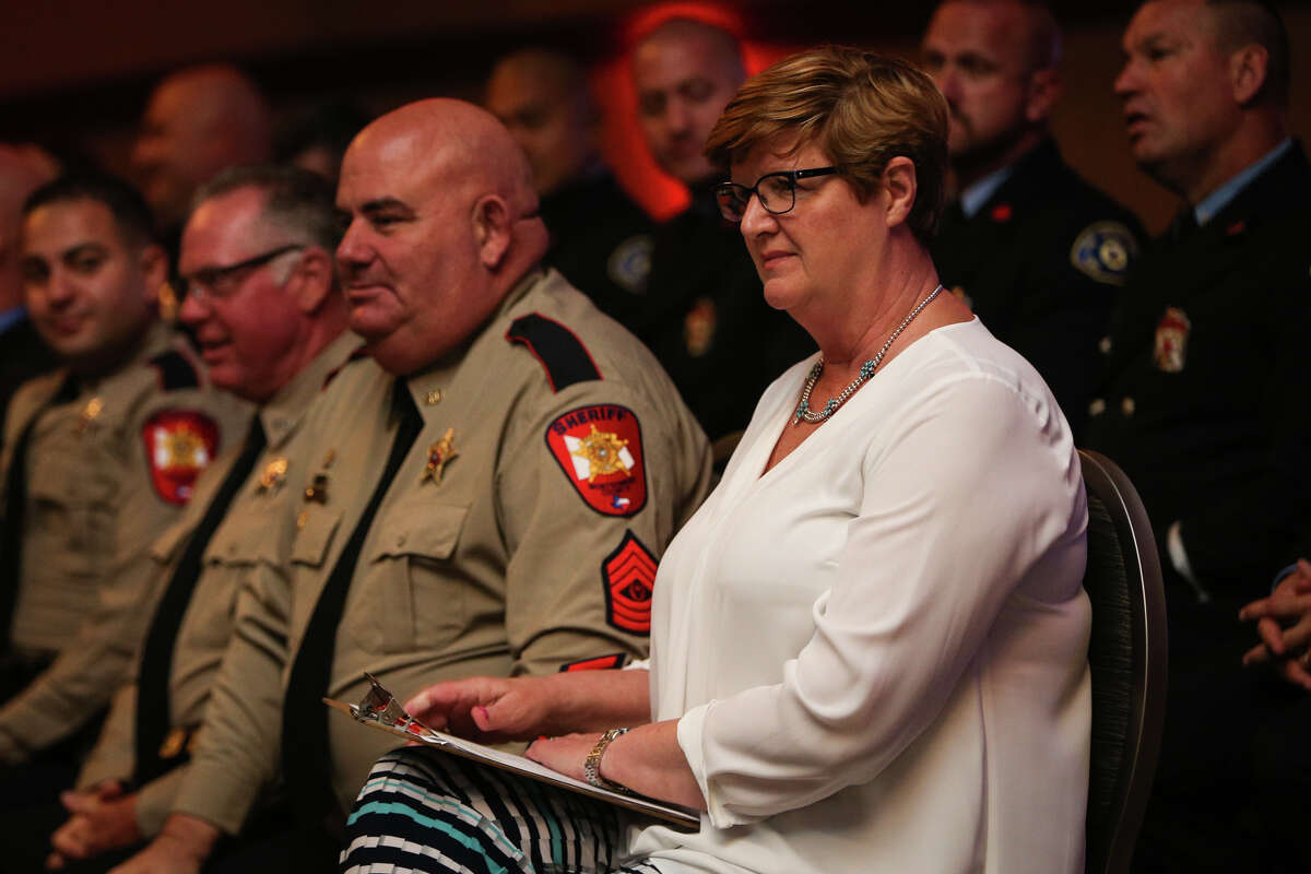 Marian Leck, Director of Law Enforcement at The Woodlands Township, organizes honorees during the Public Safety Awards Ceremony on Saturday, March 25, 2017, at The Woodlands Resort and Conference Center.