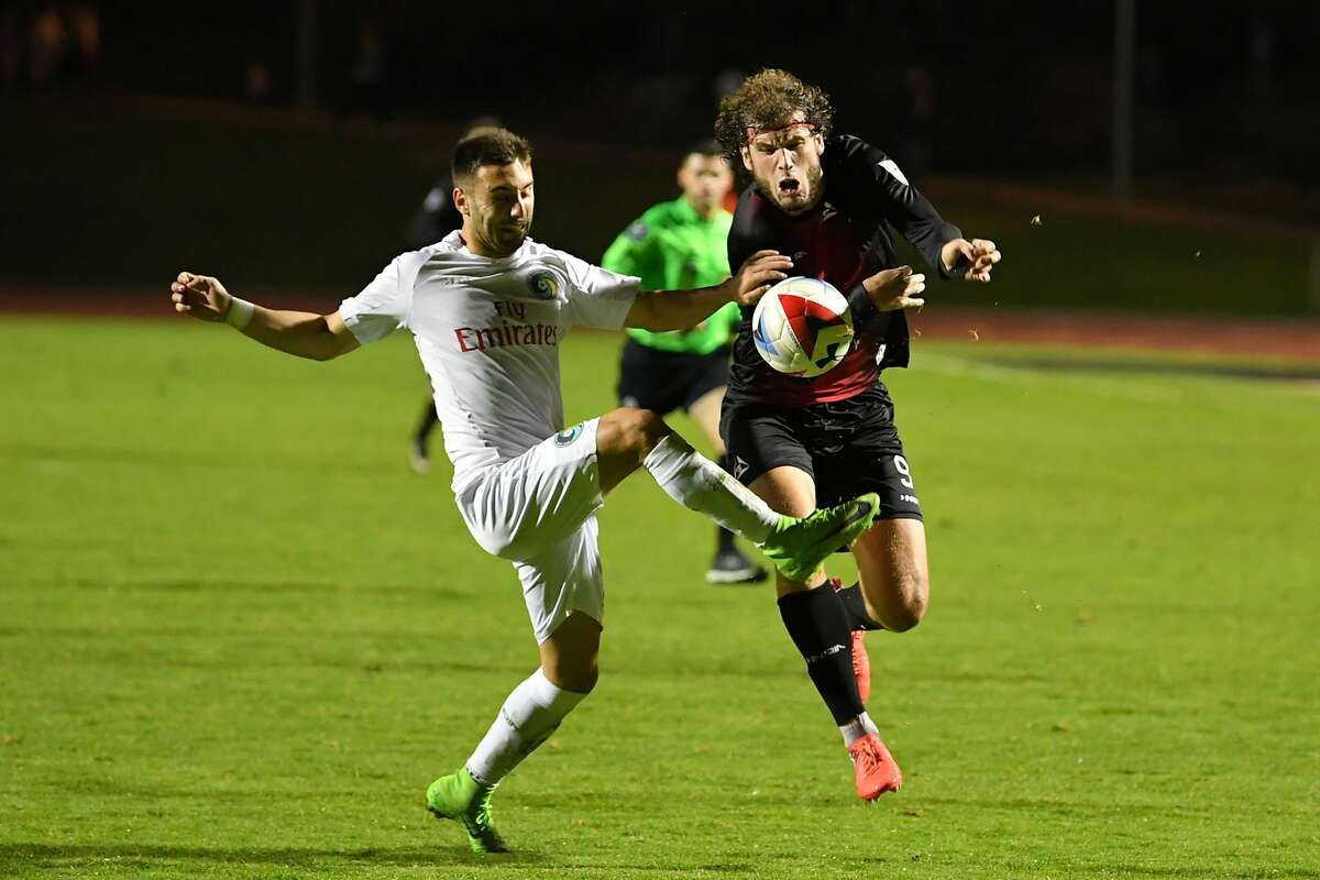 The Deltas Tommy Heinemann and the Cosmos James Mulligan fight for a loose ball on November 12, 2017 in San Francisco, CA during the NASL Championship Finals between the New York Cosmos and San Francisco Deltas at Kezar Stadium in Golden Gate Park.