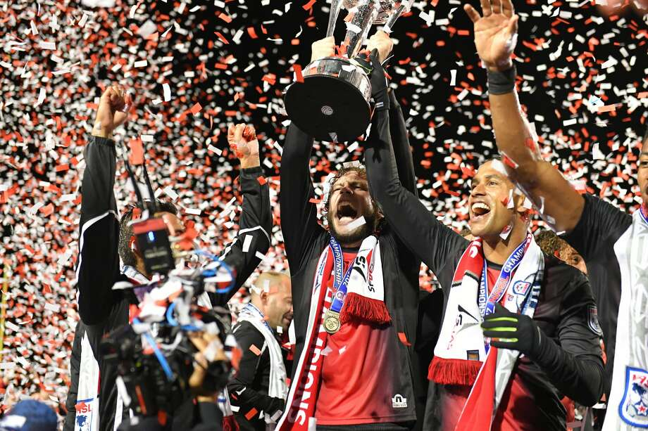 Tommy Heinemann (center) and Reiner Ferreira (right) celebrate the San Francisco Deltas defeating the New York Cosmos to win the NASL Championship on November 12, 2017 at Kezar Stadium in Golden Gate Park in San Francisco, CA. Photo: Robert Edwards/Robert Edwards-KLC Fotos