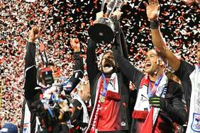 Tommy Heinemann (center) and Reiner Ferreira (right) celebrate the San Francisco Deltas defeating the New York Cosmos to win the NASL Championship on November 12, 2017 at Kezar Stadium in Golden Gate Park in San Francisco, CA.