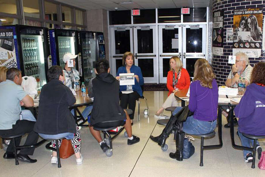 Members of the Humble ISD Citizens Bond Advisory Committee listen to assistant superintendent Cathy Airola andPE facilitator Helen Wagner discuss the addition of elementary school multipurpose rooms during the Nov. 6 CBAC meeting. Photo: Courtesy Of Www.humbleisd.net