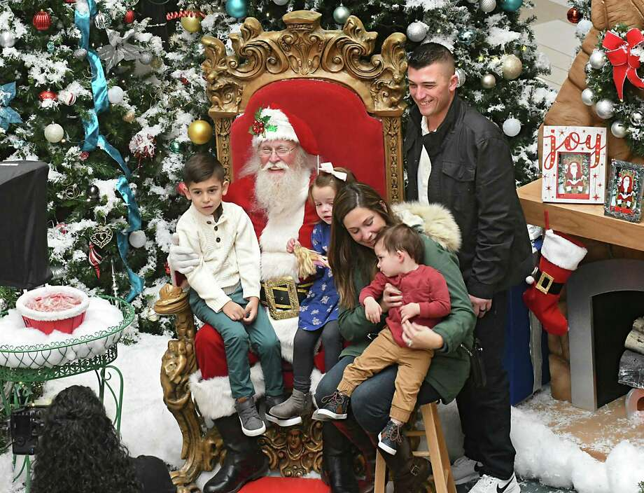 The Welch family from Coxsackie, from left, Daegan, 5, Perri, 3, Erin, Rohen, 1 1/2, and D.J. get their photo taken with Santa at Crossgates Mall on Black Friday Nov. 24, 2017 in Guilderland, N.Y. (Lori Van Buren / Times Union) Photo: Lori Van Buren, Albany Times Union / 20042192A