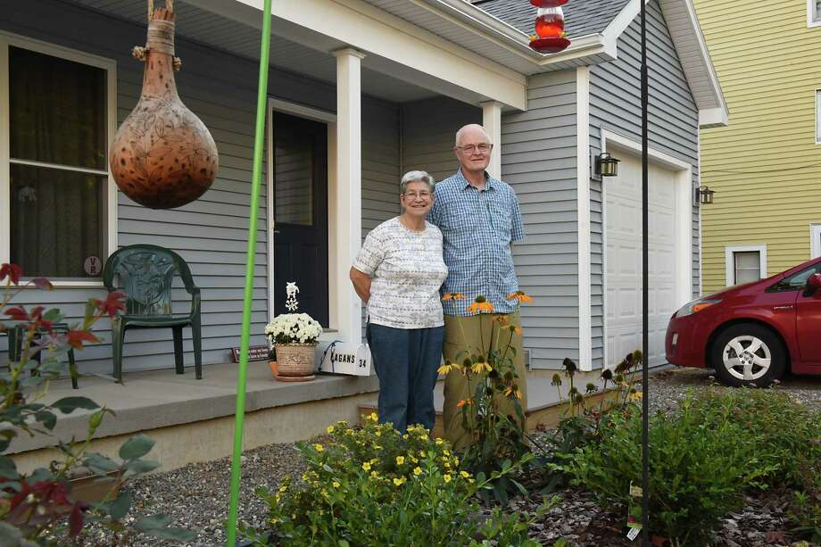 Debra and Eric Fagan stand outside their home on Monday, Oct. 2, 2017 in Albany, N.Y. The couple went through the Albany County Land Bank to purchase vacant lots in the South End to build the home they now live in at 34 Osborne. (Lori Van Buren / Times Union) Photo: Lori Van Buren / 20041705A