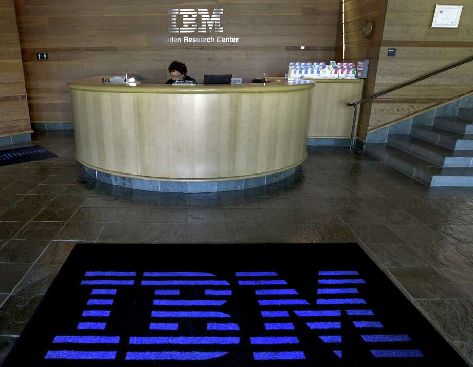 A welcome mat features an International Business Machines Corp. (IBM) logo in the lobby of the IBM Almaden Research Center campus in San Jose, Calif. Tech companies view apprenticeships as addressing the shortage of workers trained in skills that growing companies need. Photo: Bloomberg News File Photo / © 2010 Bloomberg Finance LP