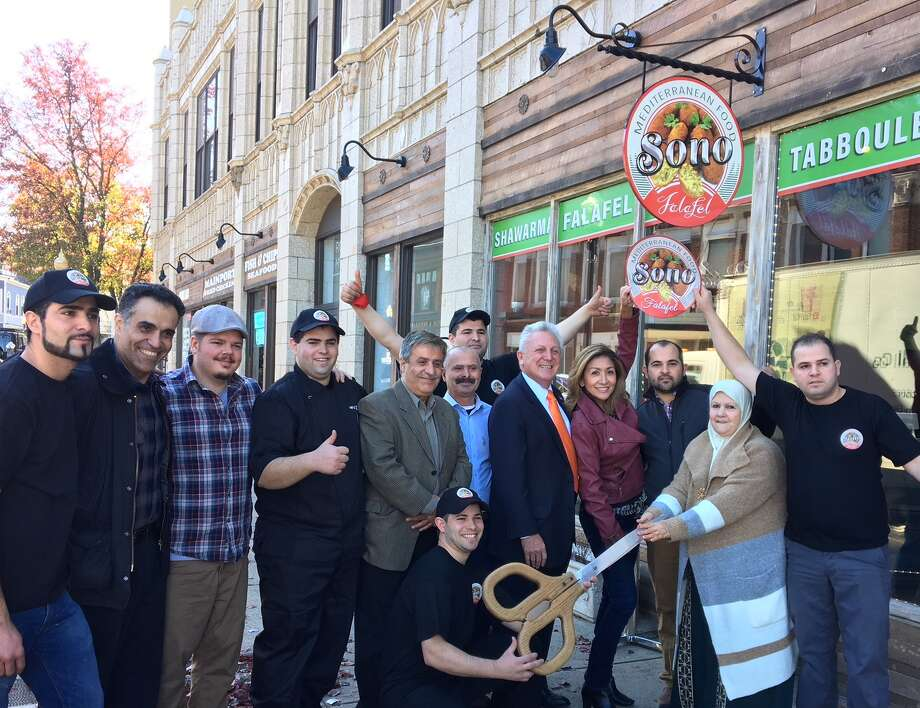 Sono Falafel, located on 46 North Main Street, is officially open for business. Mayor Harry Rilling cut the ribbon on Friday, Nov. 17 at the eatery's grand opening. Photo: Ben Vetter, Contributed
