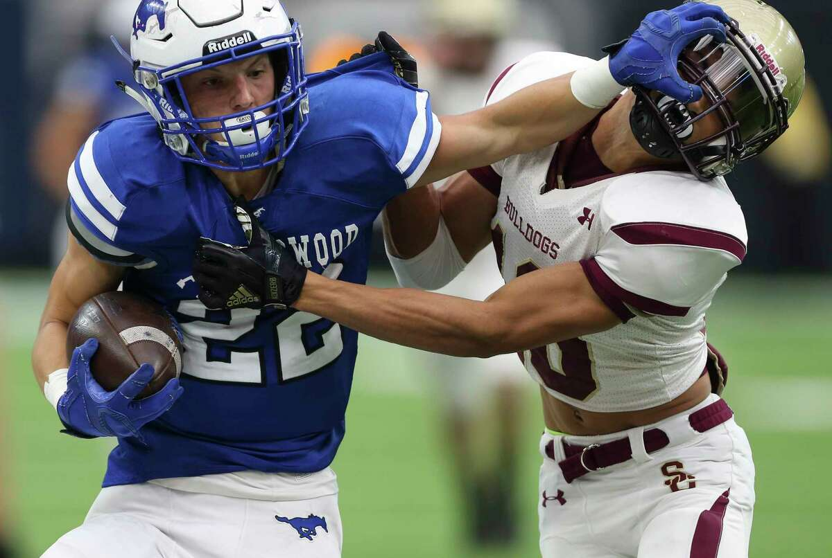 Friendswood's Mason Barnes, left, gives Summer Greek's Joseph Tucker a stiff-arm during the second quarter of the Class 6A Division 2 Area Playoffs game at NRG Stadium on Friday, Nov. 24, 2017, in Houston.