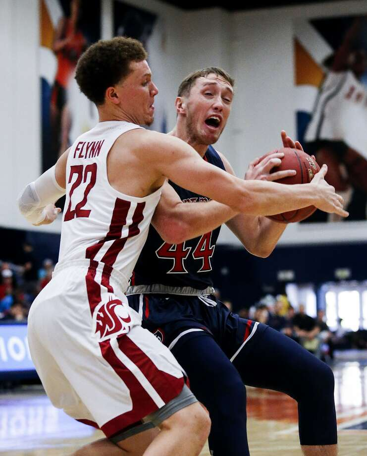 Saint Mary's guard Cullen Neal, right, dribbles against Washington State guard Malachi Flynn during the first half of an NCAA college basketball game at the Wooden Legacy tournament Friday, Nov. 24, 2017, in Fullerton, Calif. (AP Photo/Ringo H.W. Chiu) Photo: Ringo H.W. Chiu, Associated Press