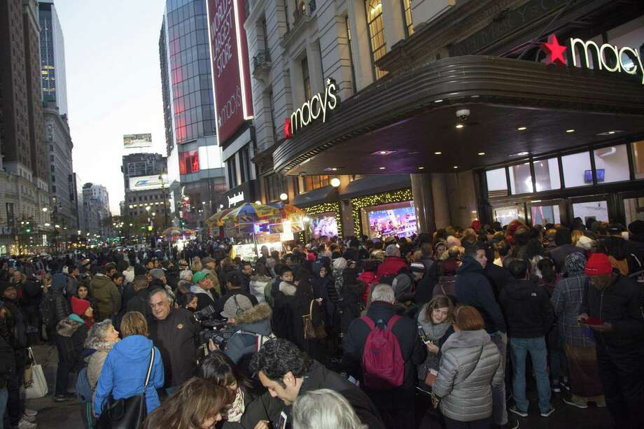 Macy's Herald Square flagship opens its doors at 5 p.m. on Thanksgiving Day for thousands of early Black Friday in New York. On Friday, Macy's Inc. was struggling to process credit cards in its stores, a painful setback as the retailer kicks off the holiday season. Photo: Andy Kropa /Associated Press / AP Images