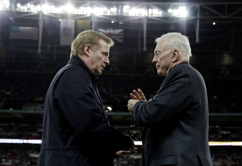 NFL Commissioner Roger Goodell, left, and Dallas Cowboys owner Jerry Jones conversed during the game between the Cowboys and Jacksonville Jaguars at Wembley Stadium in London. That was during happier times. Now, the two are feuding, and one of our readers is on Jones' side. Photo: Matt Dunham /Associated Press / Copyright 2017 The Associated Press. All rights reserved.