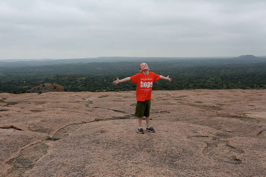 Rowan celebrates his time at the top of Enchanted Rock on June 14, 2016. The trip to Enchanted Rock, one of Rowan's favorite places, was on the bucket list of activites before leaving Texas for Seattle. Rowan believed the top of Enchanted Rock was the highest point in Texas. He said it was the closest place to God that he could climb.