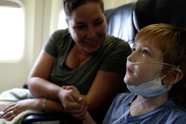 "Rowan and Carrie fly to Seattle on Nov. 4, 2015, for medical appointments and procedures to prepare for his bone marrow transplant the following summer. On the plane Rowan confronted a woman who made a racist comment about another passenger. He told her he had been bullied before and it didn't feel good. She said, ""I'm sorry,"" and Rowan replied, ""You should be."""