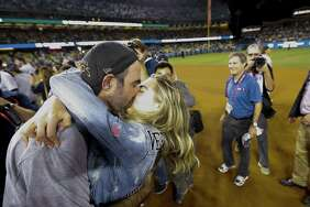Houston Astros win helped boost Fox affiliate KABB in prime time ratings. Here, starting pitcher Justin Verlander (35) kisses Kate Upton after winning Game 7 of the World Series.