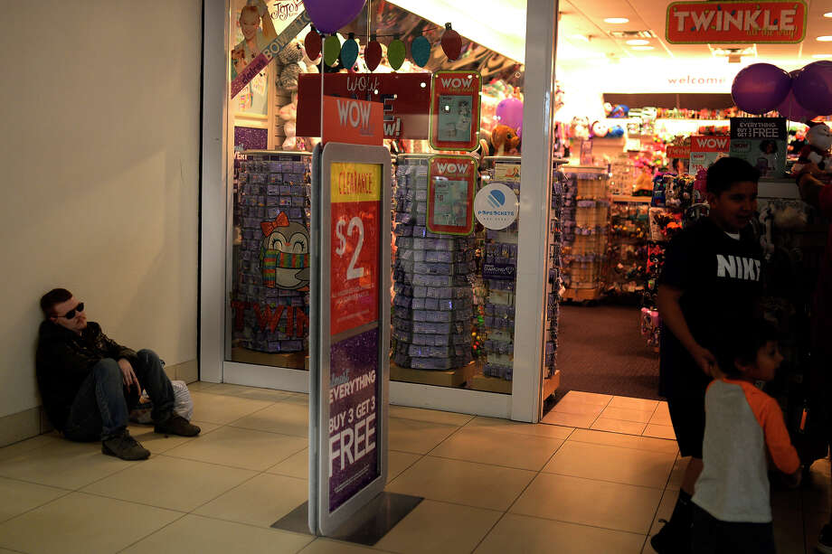 Dalton Smith waits for his fiancee outside the Claire's store in the Midland Park Mall Nov. 24, 2017. Smith, a resident of Big Spring, came to Midland with his fiancee in the morning for Black Friday shopping. James Durbin / Reporter-Telegram Photo: James Durbin