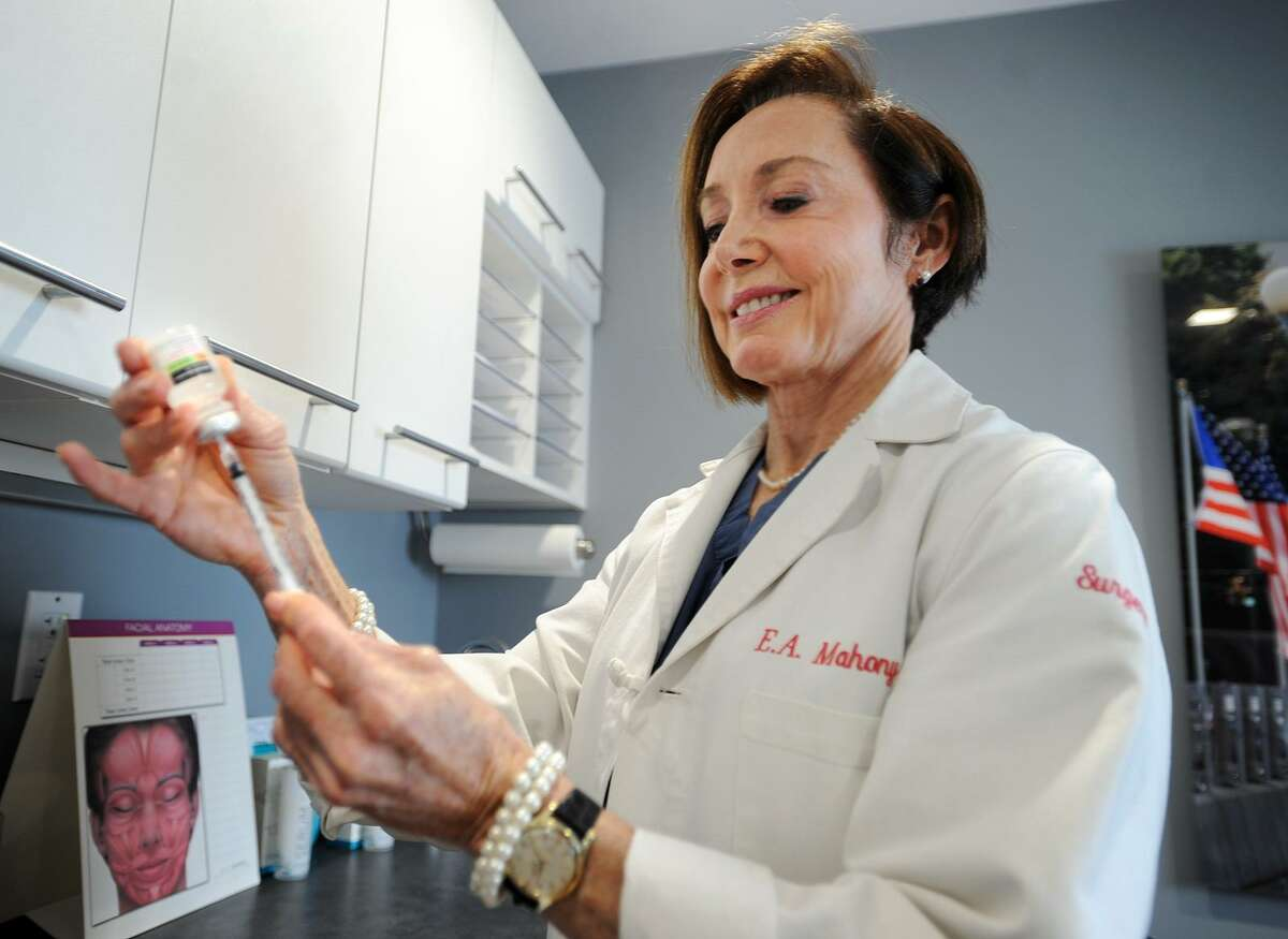 Board certified plastic surgeon Dr. Ellen Mahoney draws up a calcium gluconate activator for platelet rich plasma in her medical offices in Westport, Conn. on Tuesday, November 21, 2017.