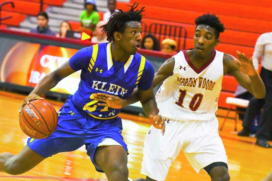 Klein's Darius Green drives to the basket against Cy Woods earlier this month. He's among the returning players for Klein this season. Photo: Tony Gaines/ HCN, Photographer