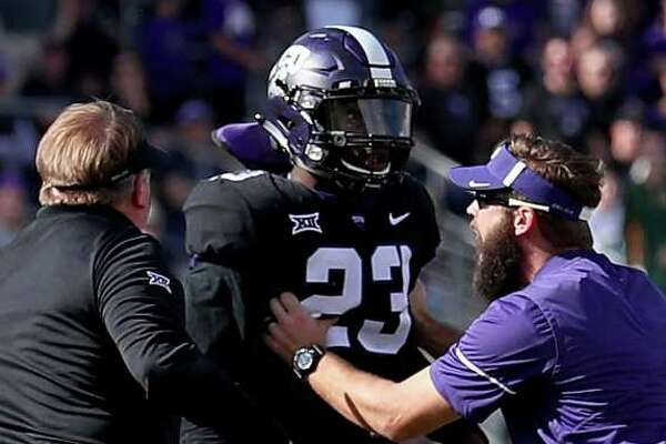 FORT WORTH, TX - NOVEMBER 24:  Head coach Gary Patterson of the TCU Horned Frogs orders his players to the sidelines after a scrum broke out against Baylor Bears in the second half at Amon G. Carter Stadium on November 24, 2017 in Fort Worth, Texas.