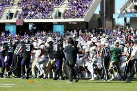 FORT WORTH, TX - NOVEMBER 24:  A fight breaks out on the field between the TCU Horned Frogs and the Baylor Bears in the second half at Amon G. Carter Stadium on November 24, 2017 in Fort Worth, Texas.