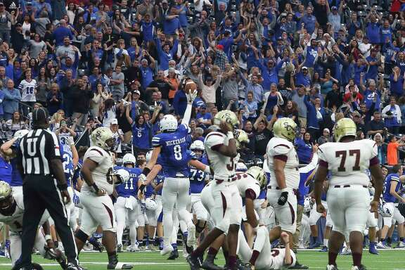 Friendswood fnas cheer for the team's win as Reid Nickerson recovers the ball from Summer Creek's attempt for a field goal during the final seconds during the second half of the Class 6A Division 2 Area Playoffs game at NRG Stadium on Friday, Nov. 24, 2017, in Houston. The Friendswood Mustangs defeated the Summer Creek Bulldogs 27-26.