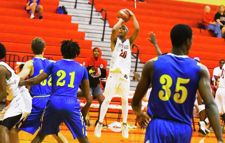 Cy Woods' Jarrid Smith goes up for a shot against Klein last week. Photo: Tony Gaines/ HCN, Photographer