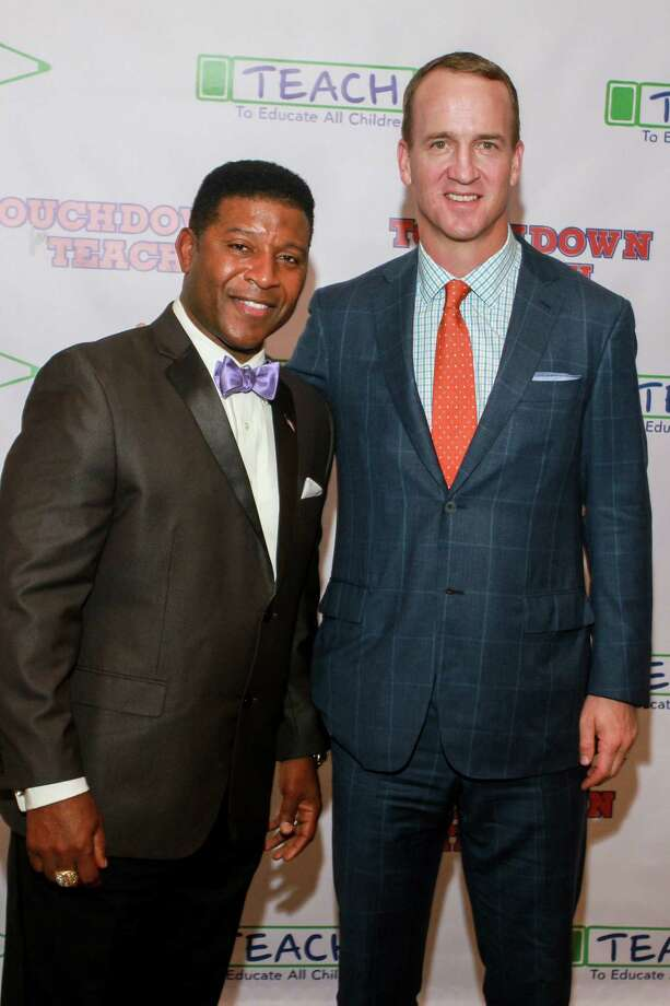 Spencer Tillman, left, and Peyton Manning Photo: Gary Fountain, For The Chronicle / Copyright 2017 Gary Fountain