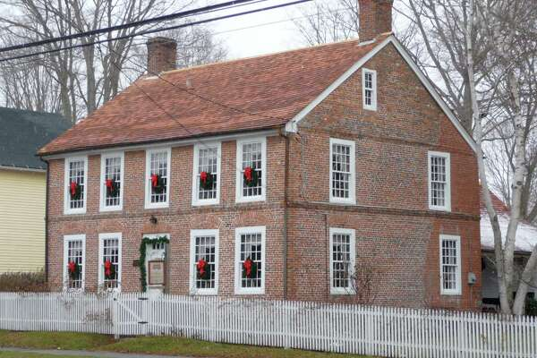 "Clinton Historical Society once again participates in the annual Christmas in Clinton Open House on Sunday, Dec. 3. The Society will open free to the public its headquarters, the 1750 Captain Elisha White House aka ""Old Brick"" located at 103 East Main Street, Clinton, from 2-6 p.m. Tours, music and treats will be provided, and the gift shop will be open. The Clinton Historical Society Museum Room located in Town Hall will also be open to visitors from 2-5 p.m. Stop in to view the latest exhibit .The historic 1791 Adam Stanton House and General Store located at 63 East Main Street will be opened by the new Adam Stanton House Board of Directors and will be welcoming visitors from 2-6 p.m. All events are free and open to the public."