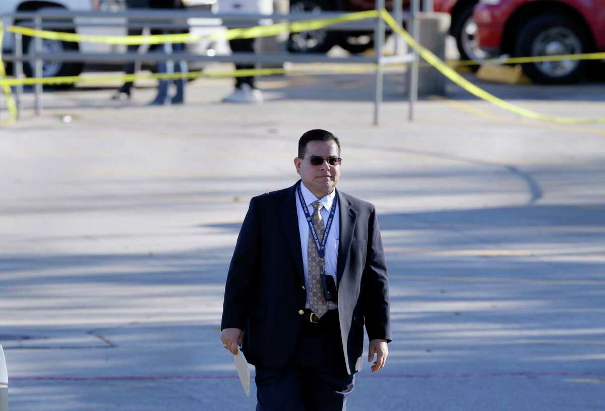 Houston Police Sgt. Richard Rodriquez goes to brief news organizations at the scene of a shooting north entrance to the Sears store at the Willowbrook Mall in Houston, Nov. 24, 2017.