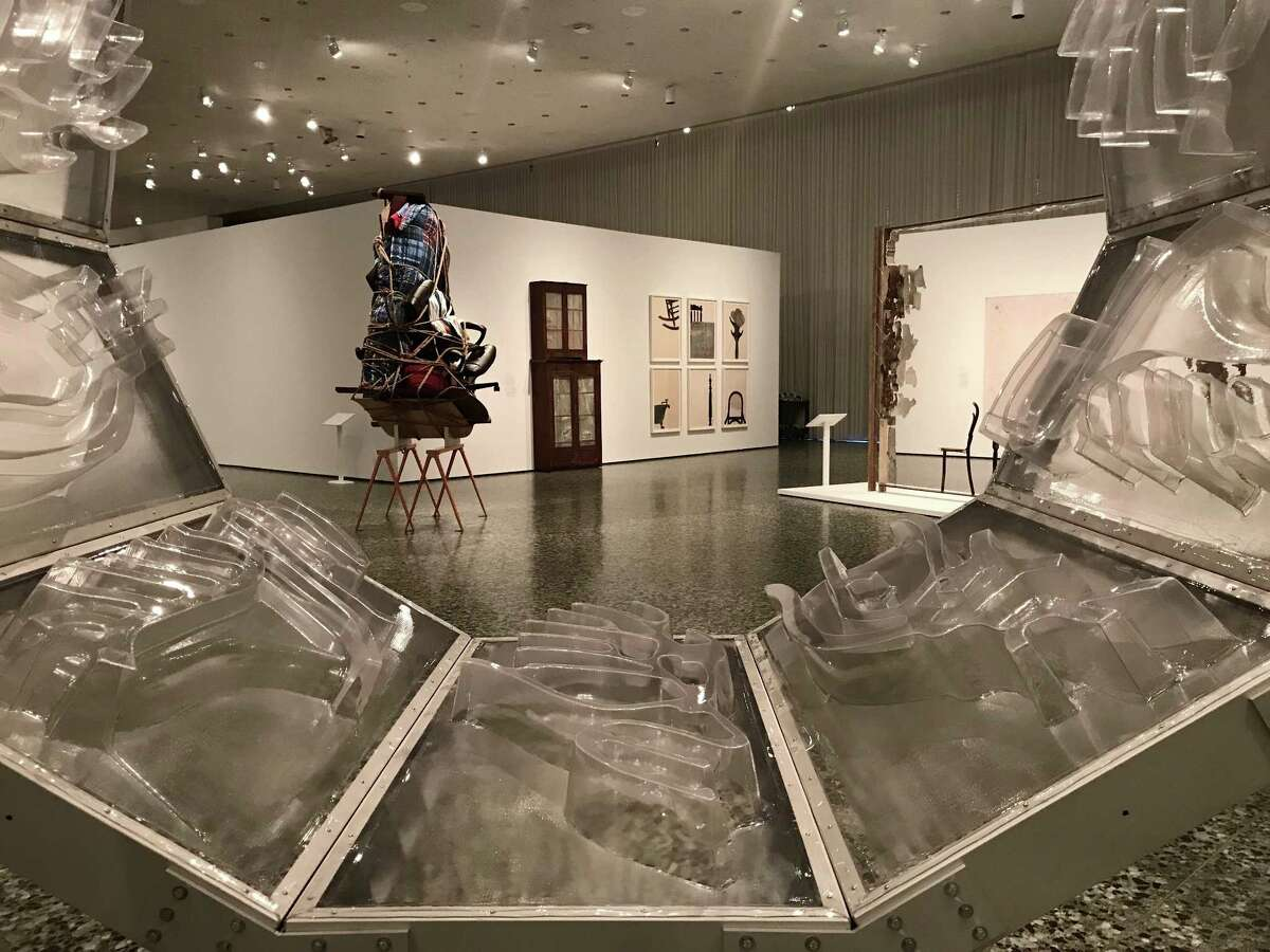 """A view of """"Home: So Different, So Appealing,"""" looking throughDaniel Joseph Martinez's """"The west bank is missing: i am not dead, am i.""""The major exhibition of works by Latin American artists is on view at the Museum of Fine Arts, Houston through Jan. 21."""