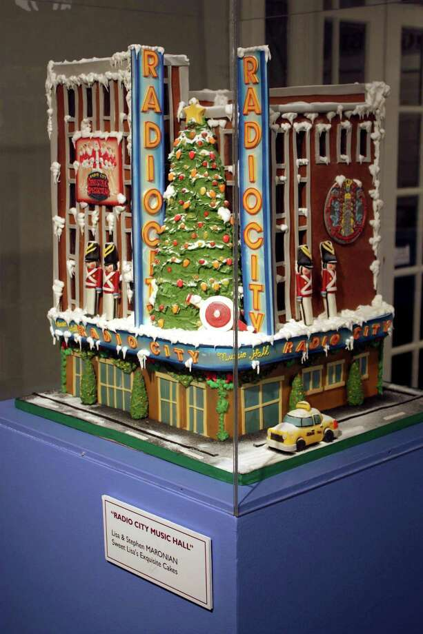 Baker Lisa Maronian, of Sweet Lisa's in Greenwich, has developed a reputation for being up to any 3-D challenge, including this cake above in the shape of Radio City Music Hall. Left, a garden grows on a Sweet Lisa's wedding cake. Photo: Contributed Photos