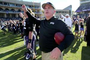 FORT WORTH, TX - NOVEMBER 24:  Head coach Gary Patterson of the TCU Horned Frogs celebrates after the TCU Horned Frogs beat the Baylor Bears 45-22 at Amon G. Carter Stadium on November 24, 2017 in Fort Worth, Texas.