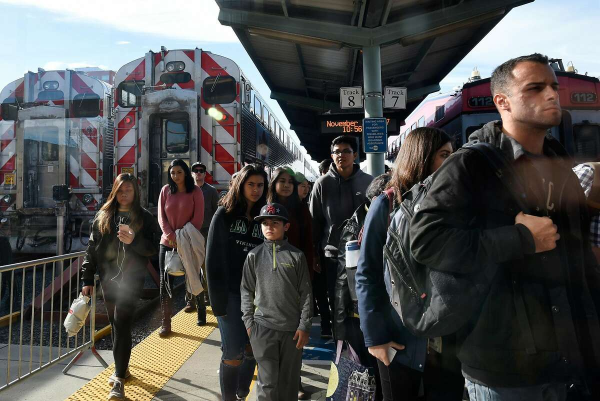 Passengers exit a train at the Caltrain yard at 4th and Townsend Streets in San Francisco, CA, on Friday November 24, 2017.