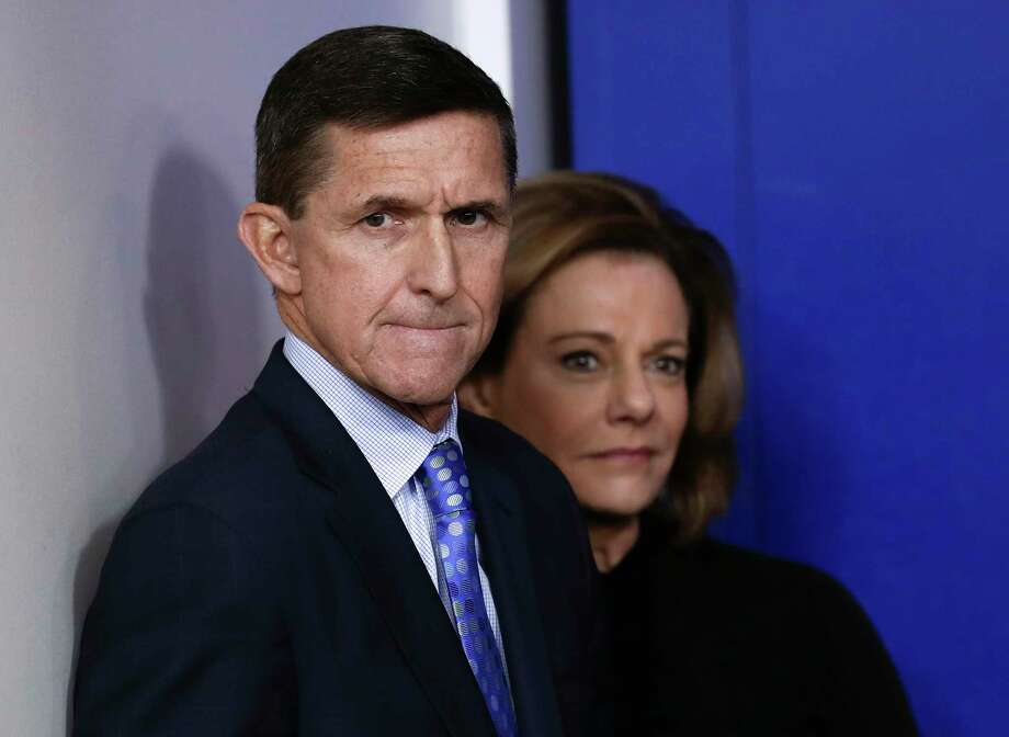 FILE - This Feb. 1, 2017, file photo shows then National Security Adviser Michael Flynn, joined by K.T. McFarland, deputy national security adviser, during the daily news briefing at the White House, in Washington. President Donald Trump says his former national security adviser, Mike Flynn, is right to ask for immunity in exchange for talking about Russia. (AP Photo/Carolyn Kaster, File) Photo: Carolyn Kaster, STF / Copyright 2017 The Associated Press. All rights reserved.