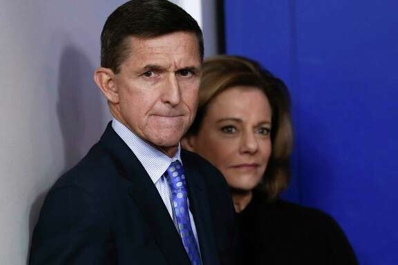 FILE - This Feb. 1, 2017, file photo shows then National Security Adviser Michael Flynn, joined by K.T. McFarland, deputy national security adviser, during the daily news briefing at the White House, in Washington. President Donald Trump says his former national security adviser, Mike Flynn, is right to ask for immunity in exchange for talking about Russia. (AP Photo/Carolyn Kaster, File)