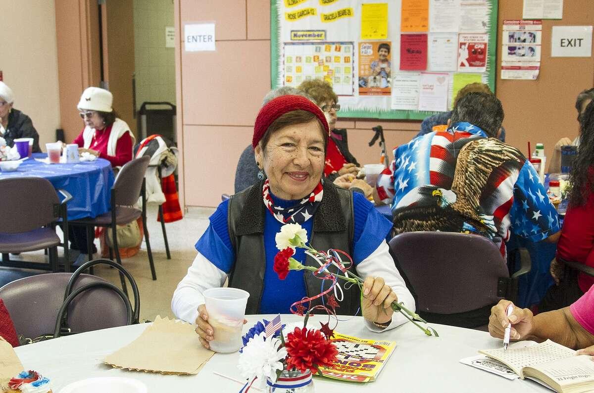 Rose Rodriguez, attends a veterans celebration at the Good Samaritan Community Services center, Thursday, Nov. 9, 2017.