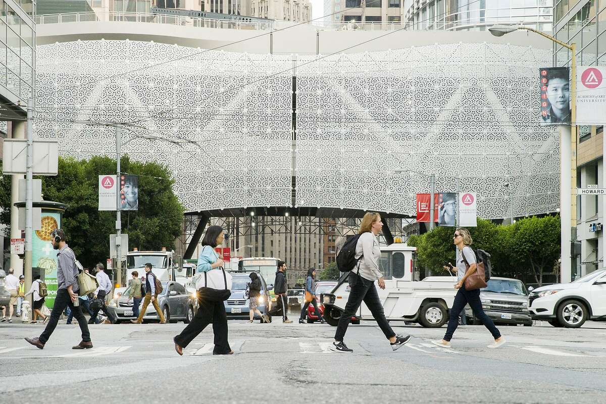 Pedestrians walk past the Transbay Transit Center on Tuesday, Sept. 12, 2017, in San Francisco, Calif.