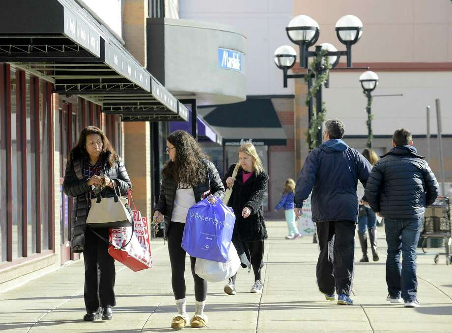 Avoid talking on cell phones while walking through malls, parking  lots, sidewalks. Phone conversations are a distraction that make you  vulnerable to robbers. Photo: Matthew Brown / Hearst Connecticut Media / Stamford Advocate