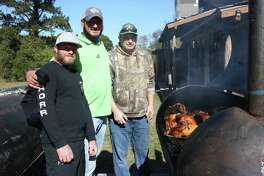 Dozens of turkeys and hams were cooked by the team of (left to right) Richard Reynolds, Cass Coroiescu and Glen Bryant for Thanksgiving at the Dove in Cleveland. Coroiescu, a New Caney-based contractor, says he wanted to share Thanksgiving with people who were alone or in need of a good home-cooked holiday meal.