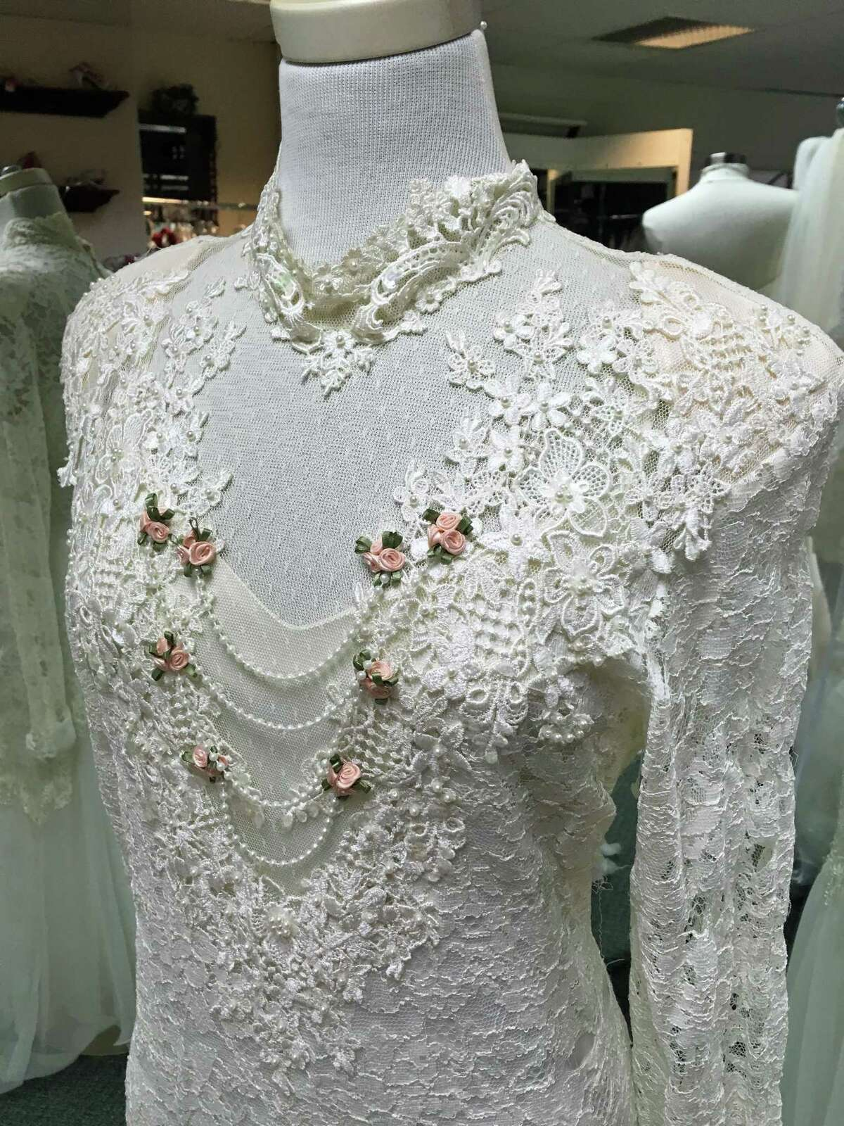 This wedding dress was among the first gowns Gail Furniss offered when she opened Occasions Bridal in Bethel 30 years ago.