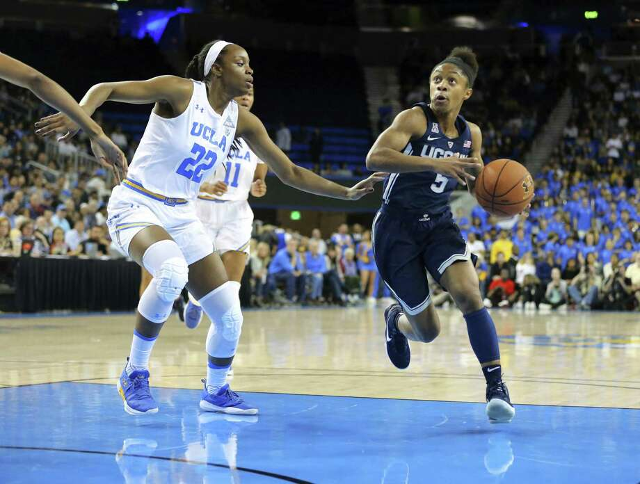 Connecticut guard Crystal Dangerfield (5) drives as UCLA guard Kennedy Burke (22) defends in the first quarter of an NCAA women's basketball game in Los Angeles Tuesday, Nov. 21, 2017. (AP Photo/Reed Saxon) Photo: Reed Saxon / Associated Press / Copyright 2017 The Associated Press. All rights reserved. This material may not be published, broadcast, rewritten or redistribu