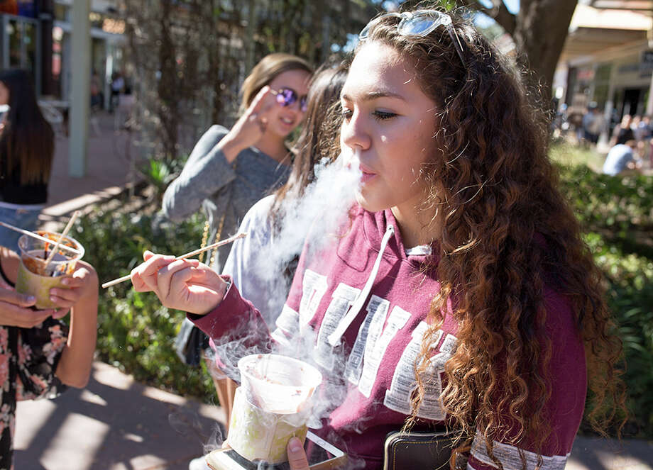 "San Antonio shoppers provide a steamy look of the liquid nitrogen-infused ""Dragon's Breath"" at The Shops at La Cantera on Friday, Nov. 24, 2017. Photo: B. Kay Richter For MySA"