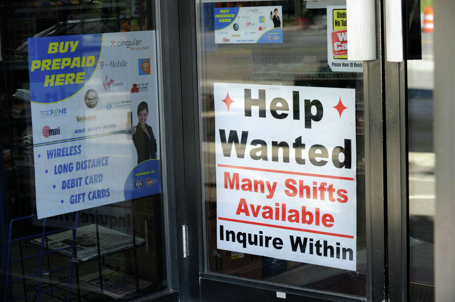 FILE - Help wanted signs are out as the job market in The Woodlands and Montgomery County continues to heat up. See whether your job pays less or more in Houston versus other cities. Photo: Carol Kaliff / The News-Times