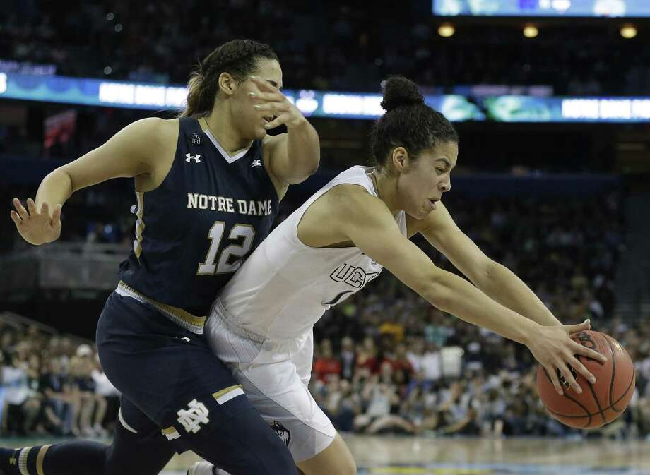 Connecticut guard Kia Nurse (11) and Notre Dame forward Taya Reimer (12) chase a loose ball during the second half of the NCAA women's Final Four tournament college basketball championship game, Tuesday, April 7, 2015, in Tampa, Fla. Connecticut won 63-53. (AP Photo/Brynn Anderson) Photo: Brynn Anderson / AP / Associated Press